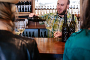 Owner Michael pouring wine at the bar