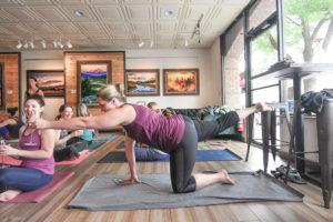 Women doing yoga with wine