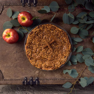 Delicious Caramel Apple Pie with apples and greenery